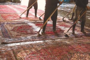 Deep Clean staff is cleaning rugs